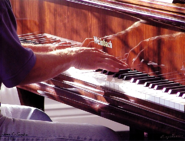 Lyle Hadlock's hands playing a Weinbach piano